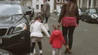 Parents driving children to school