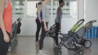 4K: Parents exercising with their babies in strollers.