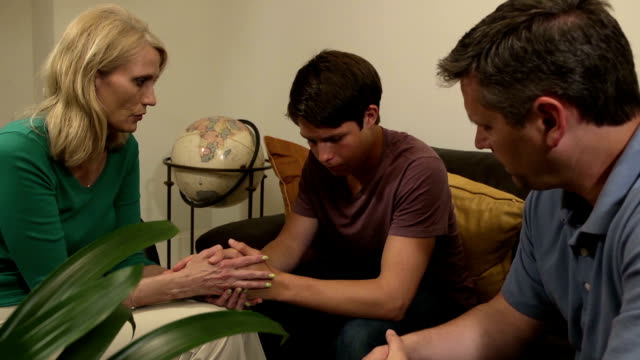 Parents have Serious Discussion with Son - Wide Shot