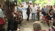 Parents of terminally ill baby Charlie Gard present petition to Great Ormond Street Hospital London EXT Various of protesters chanting 'Save Charlie...