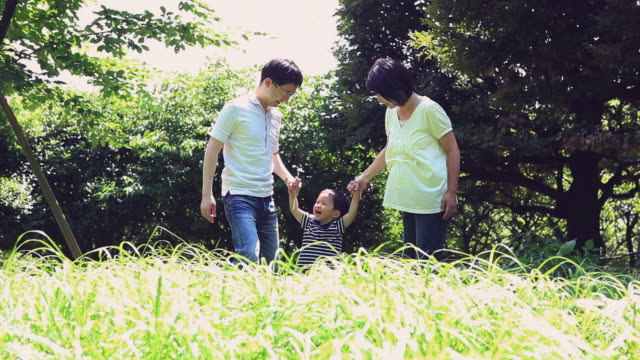 WS Parents playing with baby boy (12-17 months) in park / Shibuya, Tokyo, Japan