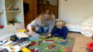Parents urged to give children jab to protect them from meningitis and pneumonia ENGLAND LOCATION Oscar Mead playing with his mother Close up of...