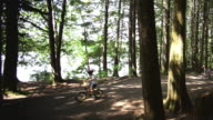WS Parents with children (8-11) cycling in Squamish Alice Lake Park / Squamish, British Columbia, Canada