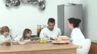 MS PAN Parents with daughter and son (6-7) eating breakfast in kitchen / Cape Town, South Africa