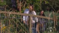 SLO MO MS PAN Parents with daughter (16-17) on footbridge / Utah, USA