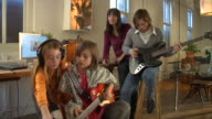 MS, Parents with two children  (8-9,10-11)  playing and recording sound at home