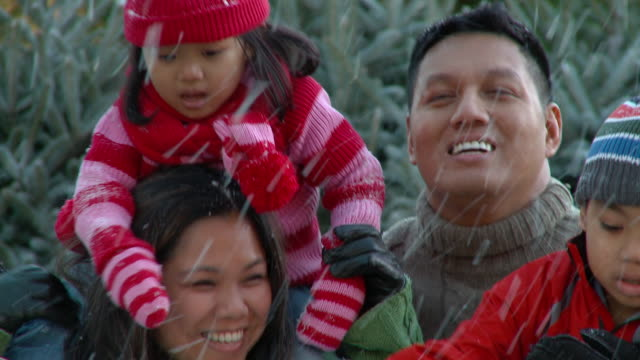 CU, TU, Parents with two children (2-3, 6-7) playing with snow, Richmond, Virginia, USA