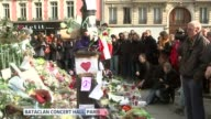 minute's silence observed across Europe Crowds stand for minutes silence around floral tributes outside Bataclan Theatre / Crowds stand in Place de...