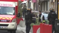 Police raids FRANCE Paris EXT Armed police next to ambulance in street / Shutters on Paris shops opening