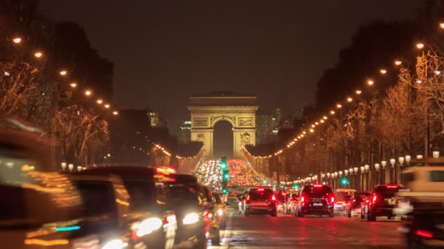 Paris, France, Arch of triumph and Champs Elysees at night, time-lapse