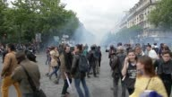 People in strike against labor reform Tear gas and people wearing helmets View of Invalides monument and Place DenfertRochereau B rolls
