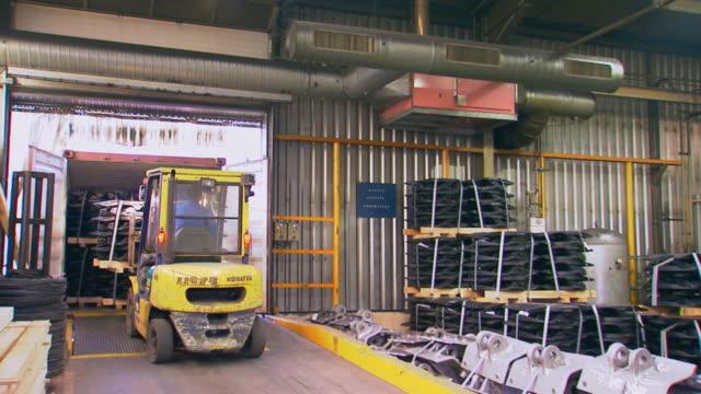 Paris, FranceForklift loading Truck