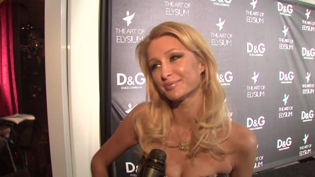 Paris Hilton on why she loves Dolce Gabbana on what she's wearing on if she has more Christmas shopping to do on what she wants for Christmas and on...