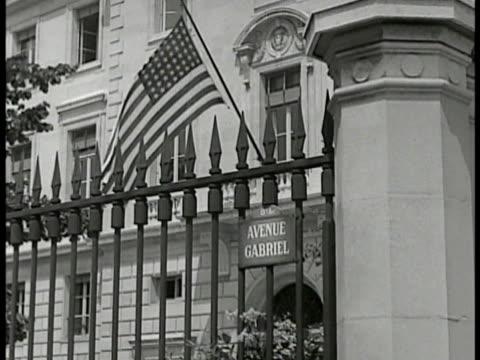 Paris Opera building city street FG MS US Embassy building w/ US flag 'Avenue Gabriel' INT MS Diplomat William C Bullitt at desk Bullitt w/ men at...