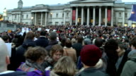 London rally at Trafalgar Square French flag 'Tricolore' being waved / 'Je Suis Charlie' placard / people gathered in Trafalgar Square / Crowd...