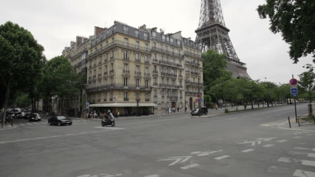 Paris street view with the Eiffel Tower in background
