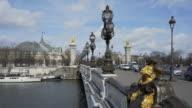 Paris winter city breaks on the Pont Alexandre III,  The Art Nouveau arched bridge.