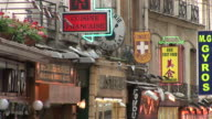 ParisView of shops signboards in City Street of Paris France