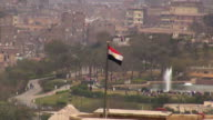 HA, WS, Park with pond and fountain, Egyptian flag in foreground, Cairo Egypt