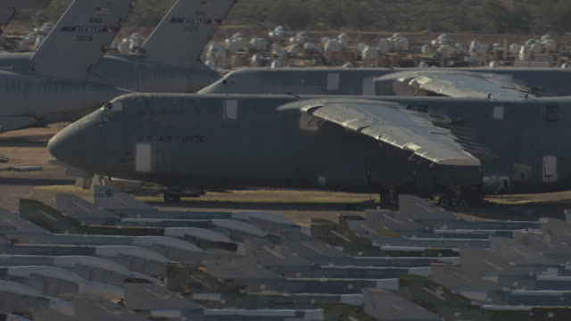 MS AERIAL Parked cargo plans with jets in Davis Monthan Air Force Base 309th Aerospace Maintenance and Regeneration Group / Arizona, United States