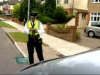 Enfield Council seeks powers to clamp foreign drivers who park illegally Traffic warden looking at car