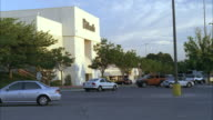 WS Parking lot in front of shopping mall with some cars / Unspecified