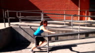 Parkour girl works her way through environment