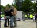 antiwar protest camp removed ENGLAND London Westminster Parliament Square EXT Officials removing antiwar protester tent Security fence around grass...