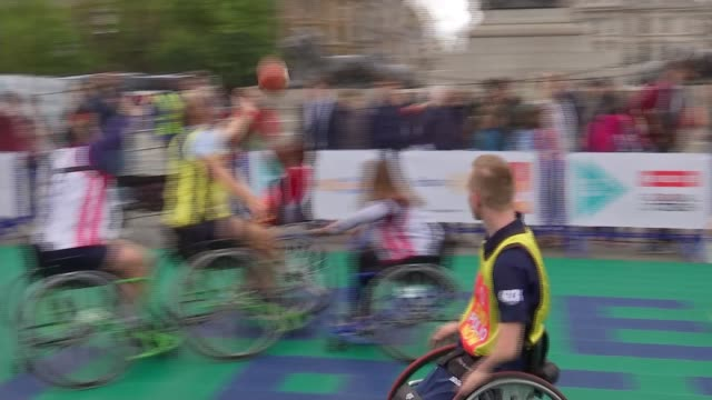 Parliamentarians teamed up with British Wheelchair Basketball teams for competitive match on World Polio Day ENGLAND London Trafalgar Square EXT...