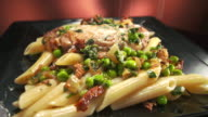 MS DS Parmesan cheese sprinkled over chicken penne dish / Los Angeles, California, United States