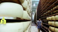 MS Parmiggiano Reggiano cheese stacked at cheese farm / Modena, Emilia Romagna, Italy