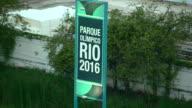 Parque Olimpico Rio 2016 sign tall green grass trees