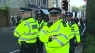 18yearold man arrested in Dover / property raided in Sunbury ENGLAND London EXT Large group of police officers outside Parsons Green London...