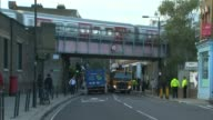 18yearold man arrested in Dover / property raided in Sunbury Parsons Green Train along over railway bridge Train along Police officers in street
