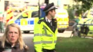 18yearold man arrested in Dover / property raided in Sunbury 1592017 ENGLAND London Parsons Green EXT Police officer gesturing Police vans with...