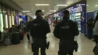 18yearold man arrested in Dover / property raided in Sunbury Euston Station Back view of armed police officers patrolling inside Euston railway...