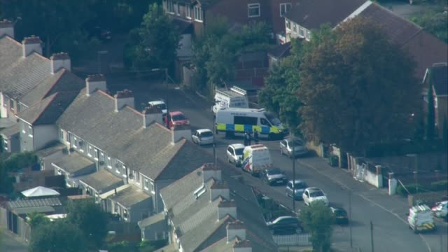 18yearold man arrested in Dover / property raided in Sunbury Surrey Sunbury Police van police officers and police tape cordons in street where police...