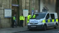 18yearold man arrested in Dover / property raided in Sunbury Parsons Green Train along over railway bridge Wide shot of police van and police...