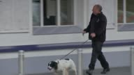 18yearold man arrested in Dover / property raided in Sunbury Kent Dover Police officer and police dog along Police van and police officer Electronic...