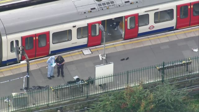 18yearold man arrested in Dover / property raided in Sunbury 1592017 Parsons Green Forensic officers on platform next to Tube train