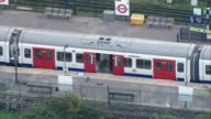 More details emerge about suspects 1592017 Parsons Green Police officer boarding Tube train AIR VIEW Forensic officers along platform and boarding...