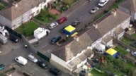 More details emerge about suspects AIR VIEW Police tents in front and back garden of house raided by police steel police cordon at end of street...