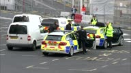 More details emerge about suspects Kent Dover EXT Wide shot police cars General view Port of Dover police van Wide shot car park