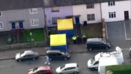 More details emerge about suspects Surrey SunburyonThames Police blue and yellow forensic tents at front of house raided by police AIR VIEW Police...