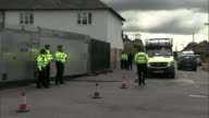 Police arrest second man / security threat lowered ENGLAND Surrey SunburyonThames EXT Police officers and police van next to barrier sealing off...