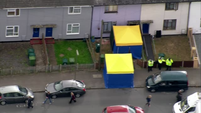 Police arrest second man / security threat lowered AIR VIEW / AERIAL Forensics tents ond police officers outside house being searched