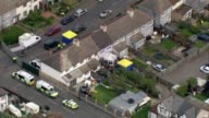 Police arrest second man / security threat lowered AIR VIEW AERIAL Cordoned off road and police forensics tents erected outside the front and back of...