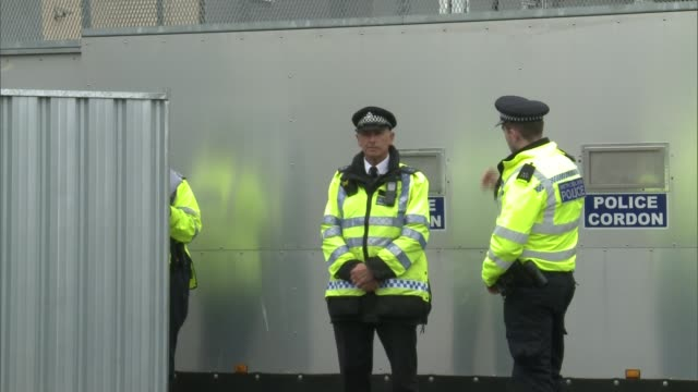 Police arrest second man / security threat lowered Surrey SunburyonThames Police officers next to barrier sealing off Cavendish Road Police officers...