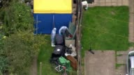 Police arrest second man / security threat lowered AIR VIEWS / AERIALS Police forensics officers and forensics tent in back garden of house being...