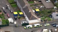 Police arrest second man / security threat lowered Surrey SunburyonThames Police tents and forensic officers in garden of house